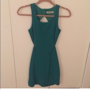 Green open back Mystic mini dress
